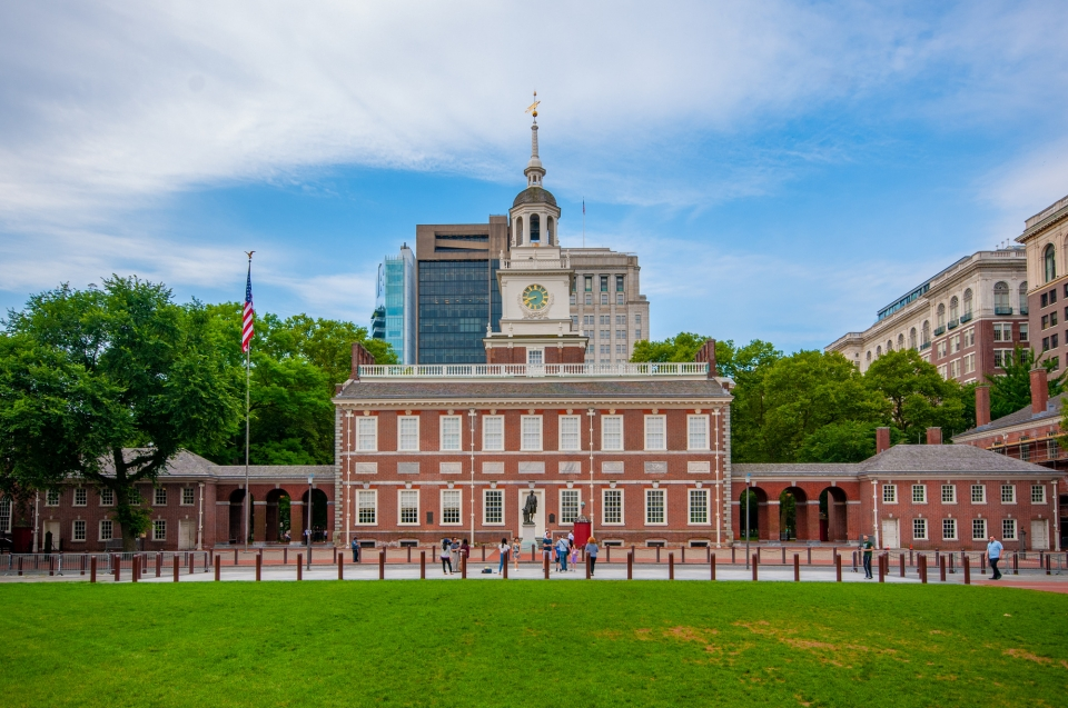 A view of the north side of Independence Hall, showing the main building in the center with the east and west wings on the sides