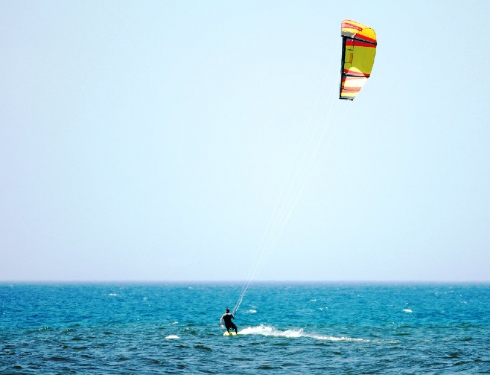 Person kiteboarding on ocean