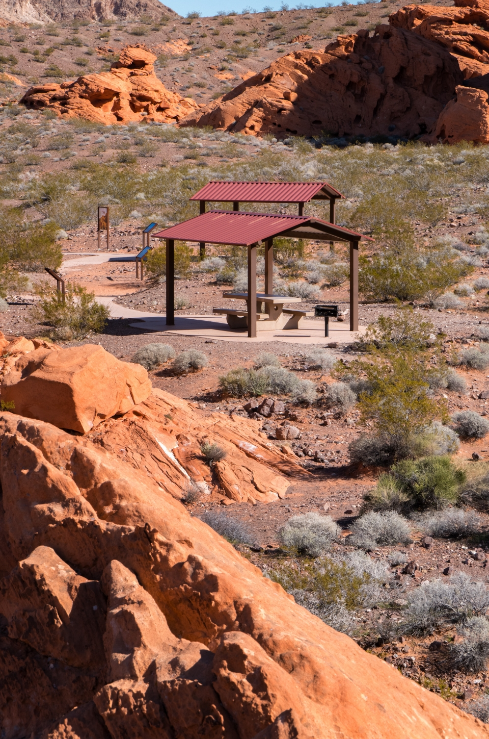 red picnic shelter amongst the red rock cliffs of Lake Mead National Recreation Area