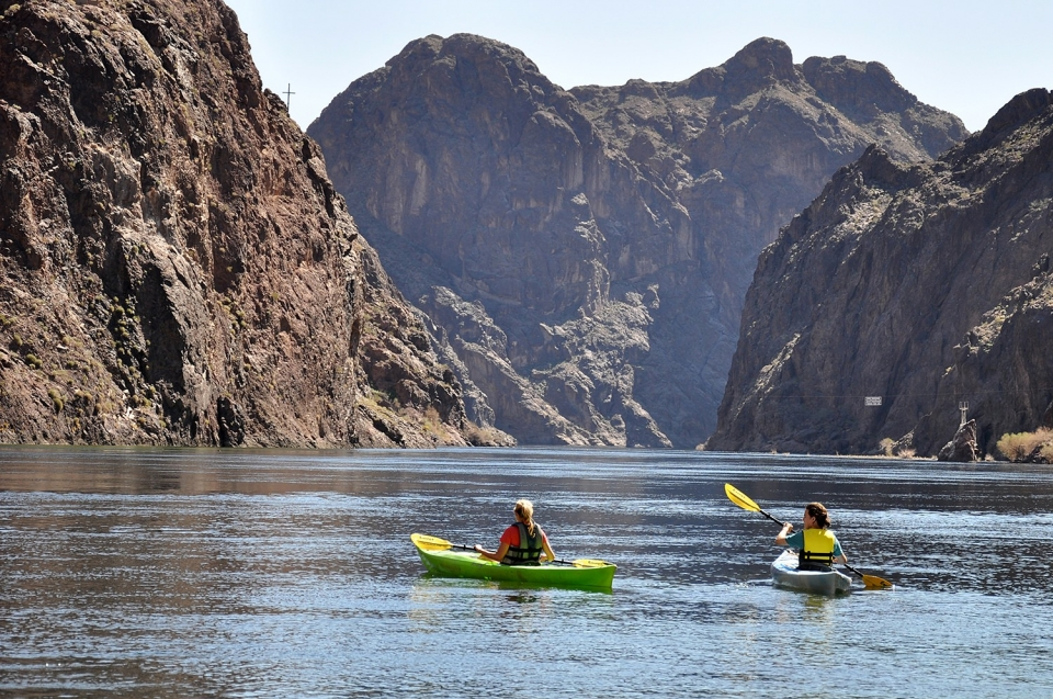Two people kayaking in the Black Canyon at Lake Mead National Recreation Area
