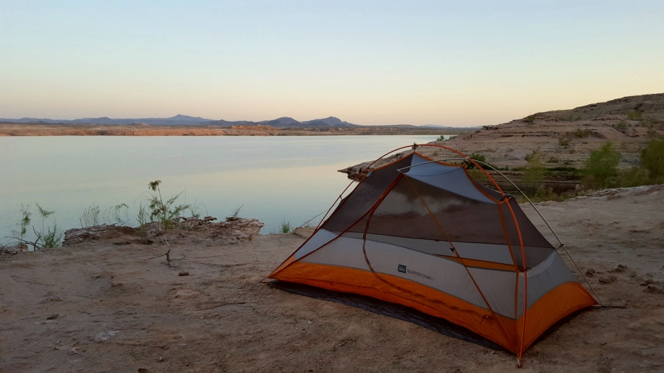 A tent pitched next to the shore of Lake Mead National Recreation Area