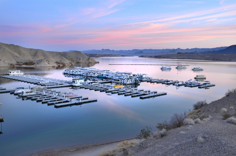 Colorful red and pink clouds in the blue sky over a pier at cottonwood Cove at Lake Mead National Recreation Area