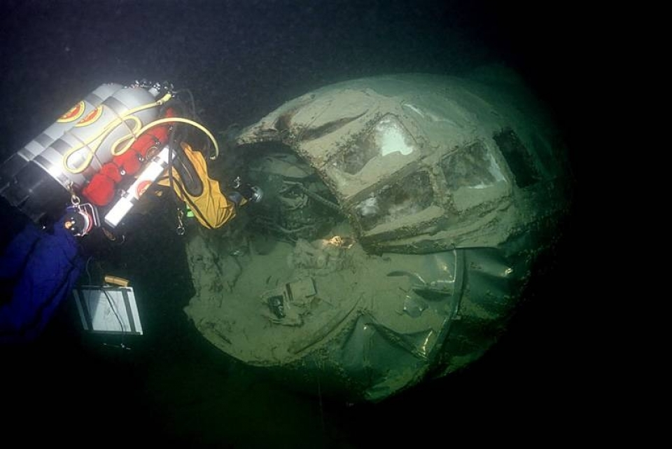 NPS archeologist working underwater to document damage on B-29 Bomber at Lake Mead