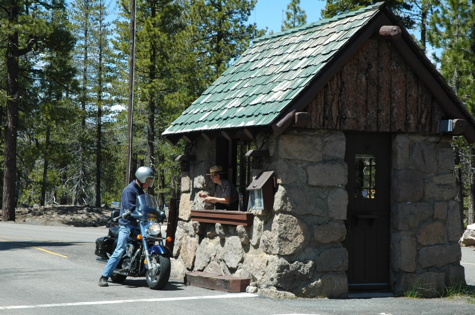 Motorcyclist at the fee booth at Lassen Volcanic National Park