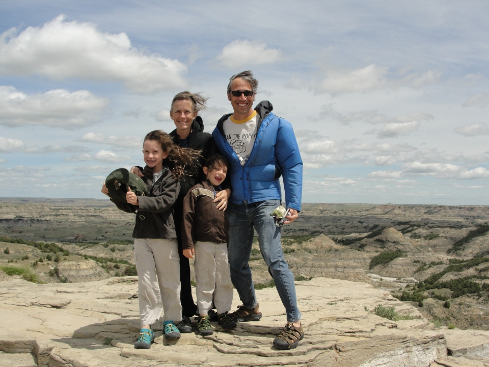 Lucy, her brother, and parents standing together, smiling at Theodore Roosevelt National Park