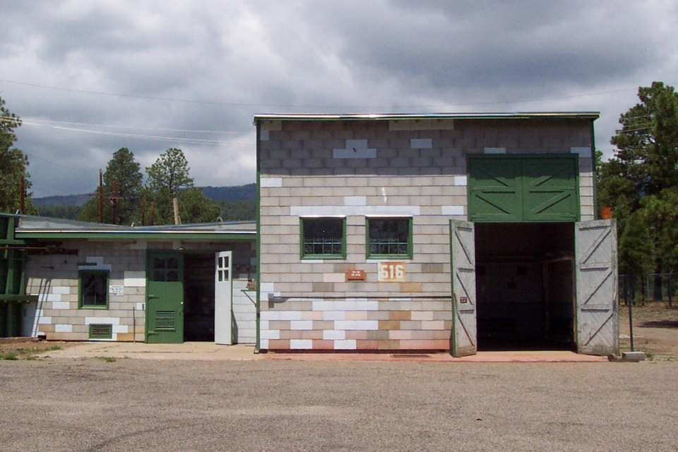 Tan and green building/shed of the V Site at Los Alamos, New Mexico