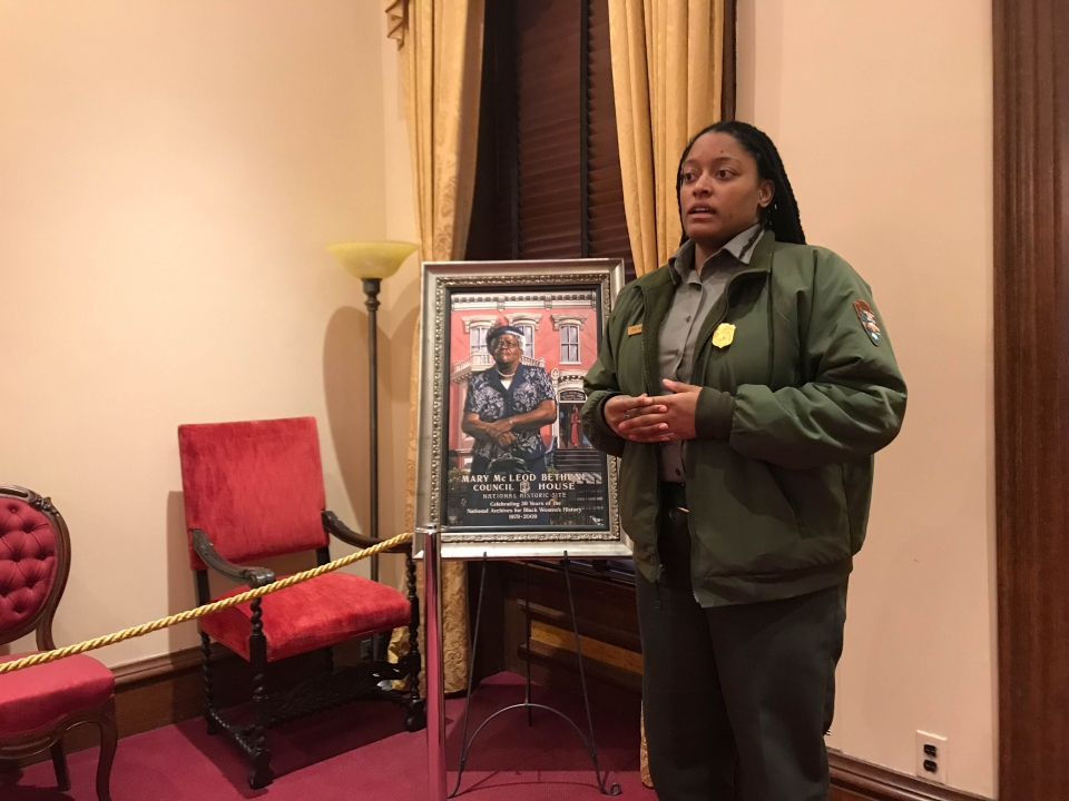 Ranger talking next to a portrait of Mary McLeod Bethune