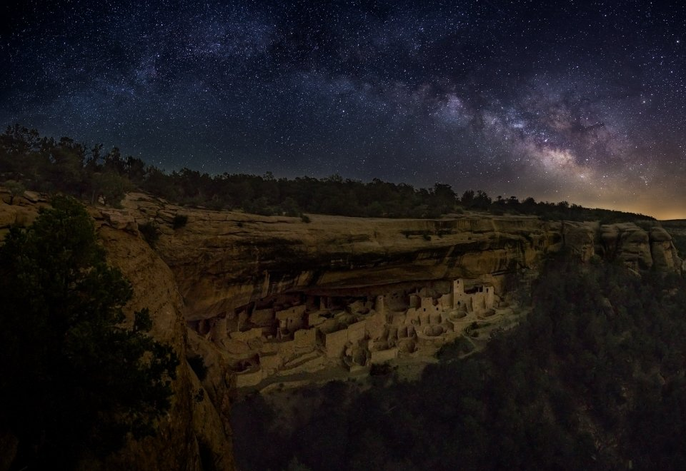 The Milky Way illuminates the sky over Mesa Verde National Park's Cliff Palace