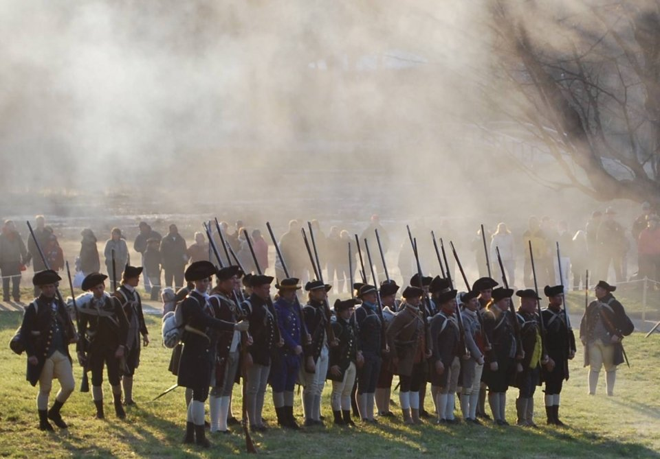 Reenactment of Captain Brown's Company preparing to open fire at Minute Man National Historical Park