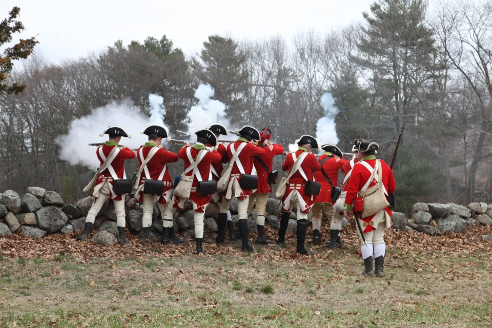 History reenactors as British troops firing on Patriot's Day at Minute Man National Historical Park
