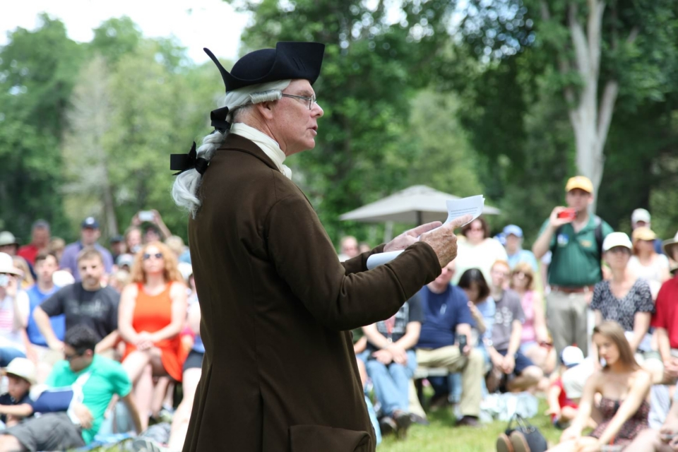 History reenactor reading the Declaration of Independence at Minute Man National Historical Park