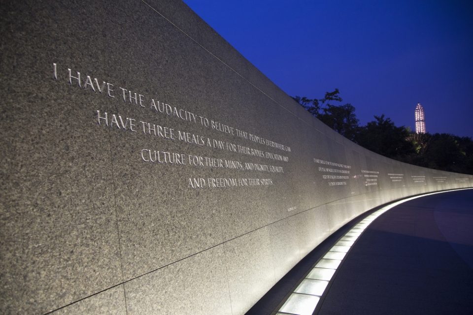 Quotes from Dr. Martin Luther King, Jr. etched into a marble wall, illuminated at nighttime