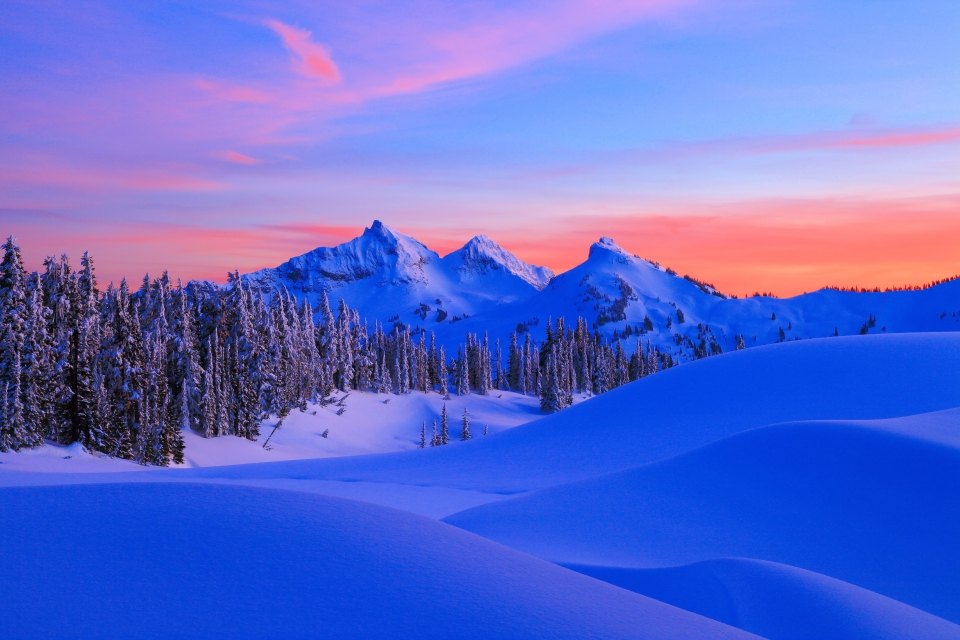 Winter sunset at a snow-covered landscape at Mount Rainier National Park