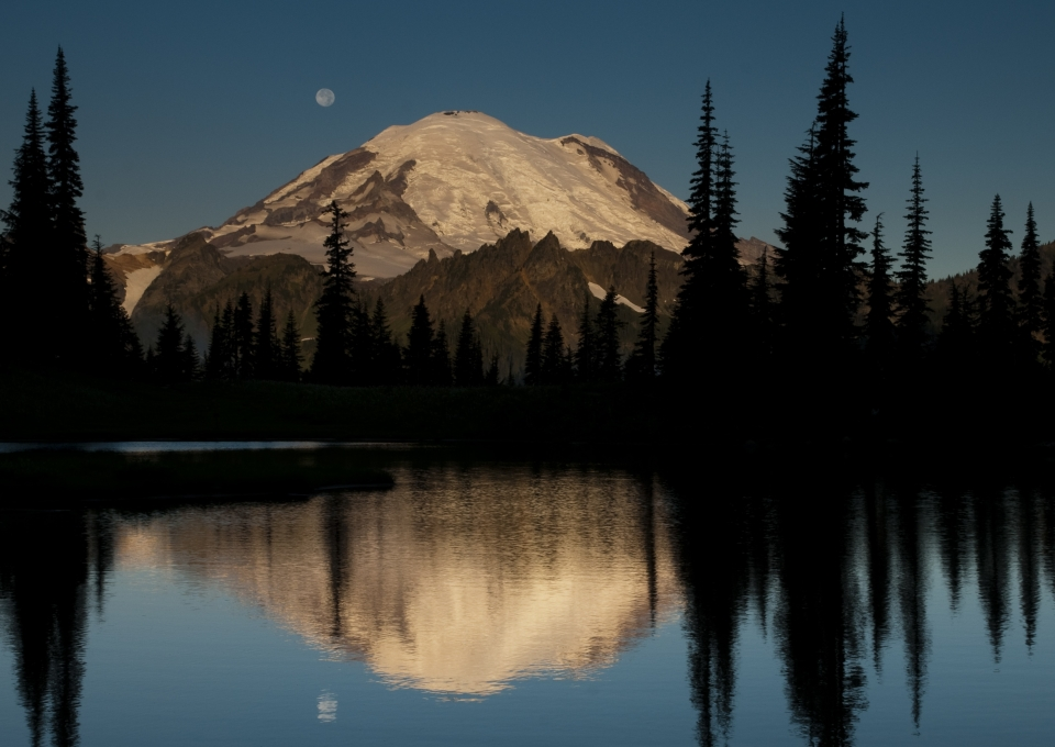 Mount Rainier at nighttime with reflection in water