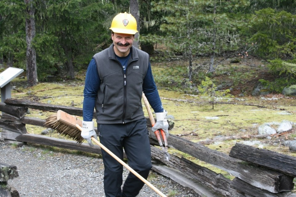 A volunteer on the Trail of the Shadows at Longmire, in Mount Rainier National Park