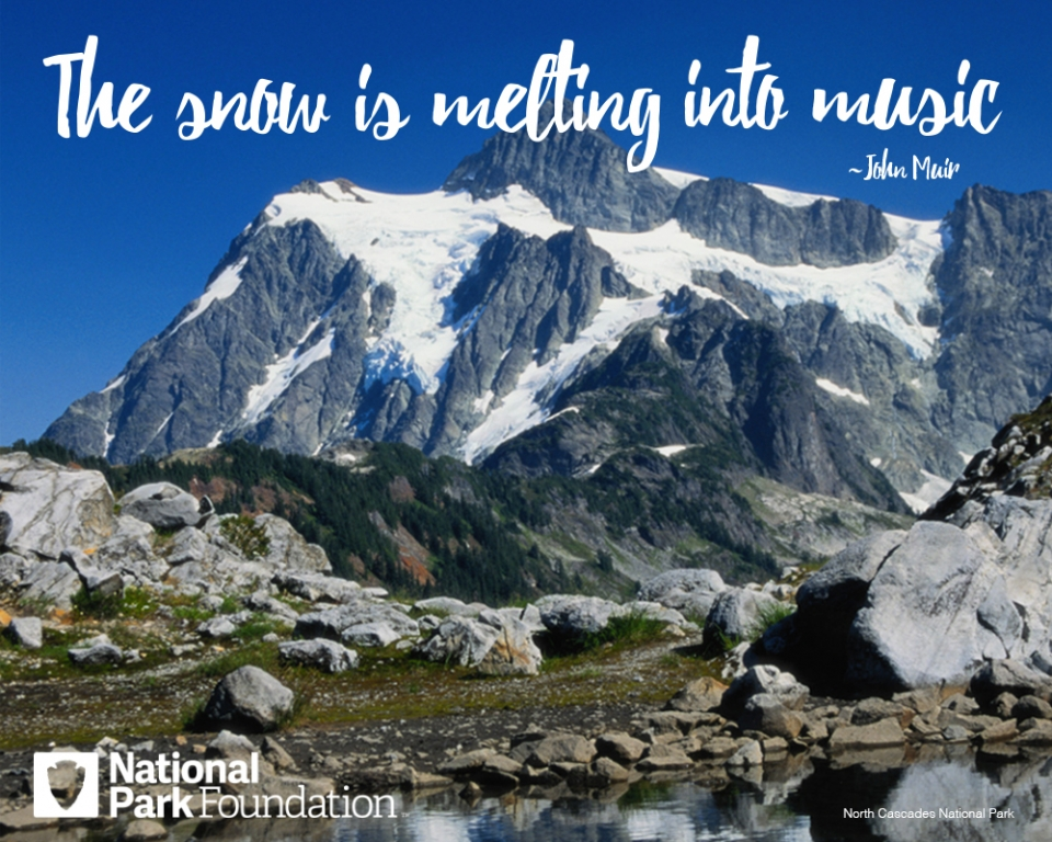 "John Muir Quote ""The snow is melting into music"" over an image of North Cascades National Park"