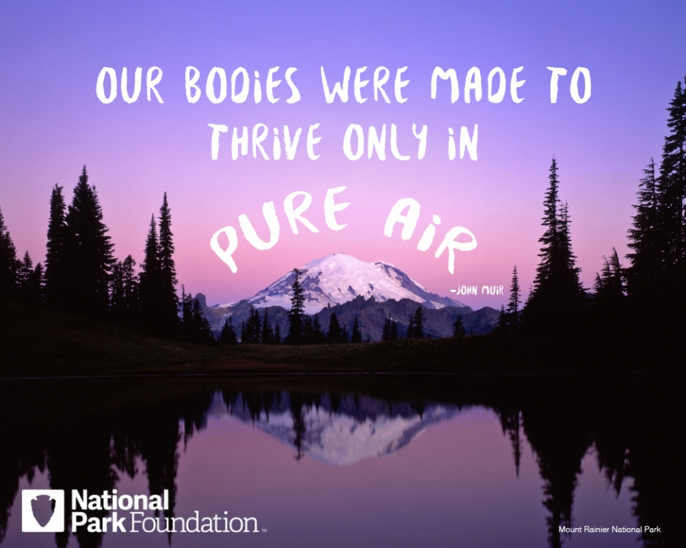 "John Muir quote ""Our bodies were made to thrive only in pure air"" over an image of Mount Rainier National Park"