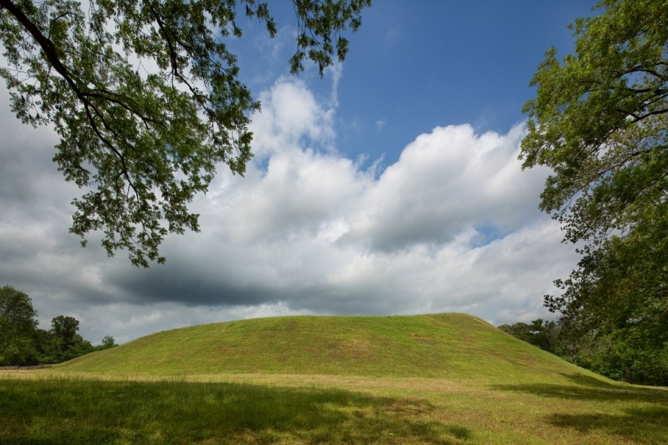 A gentle, sloping earthen mound on a sunny day