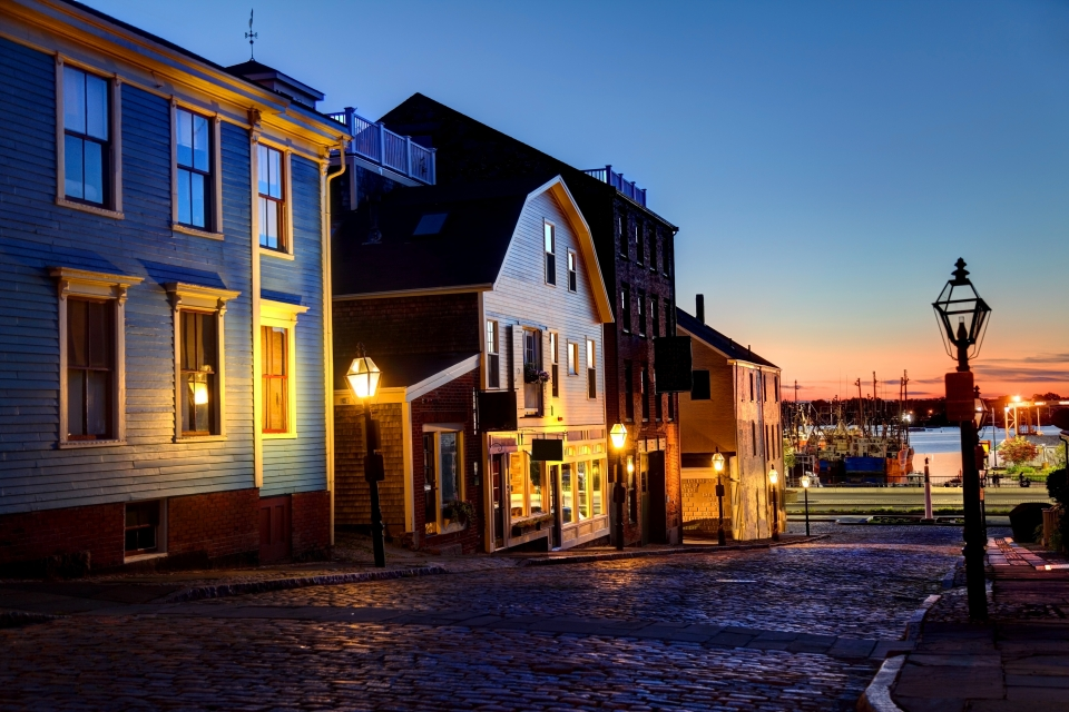 A row of historic buildings and houses at dusk
