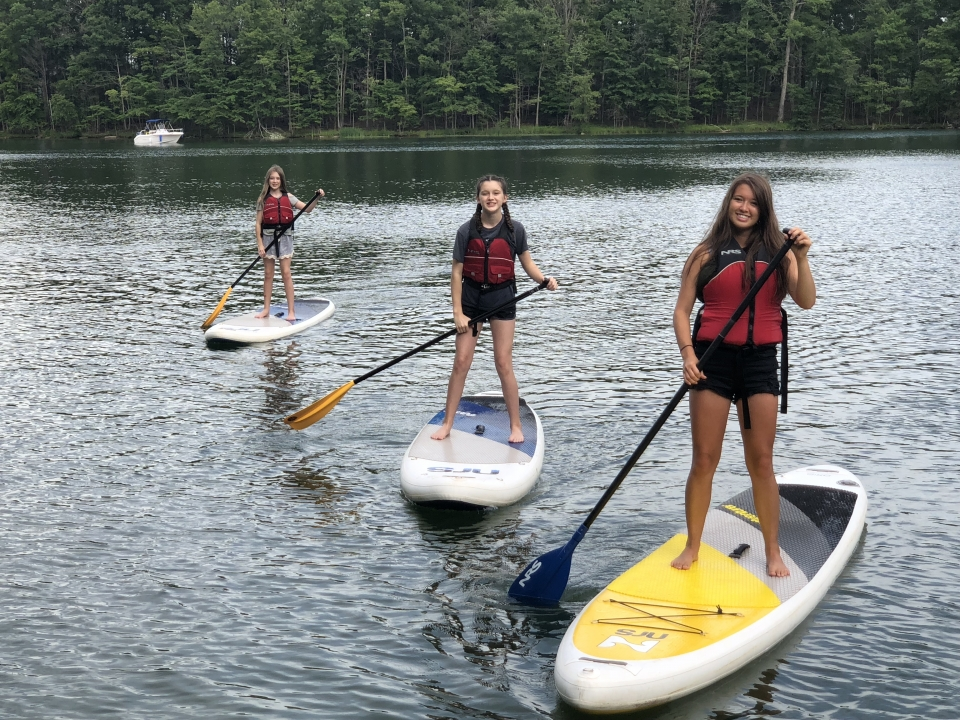 Three paddle boarders on New River Gorge National River