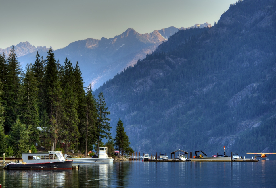 Boats and float plane dock along the banks of Lake Chelan in Stehekin, North Cascades National Park