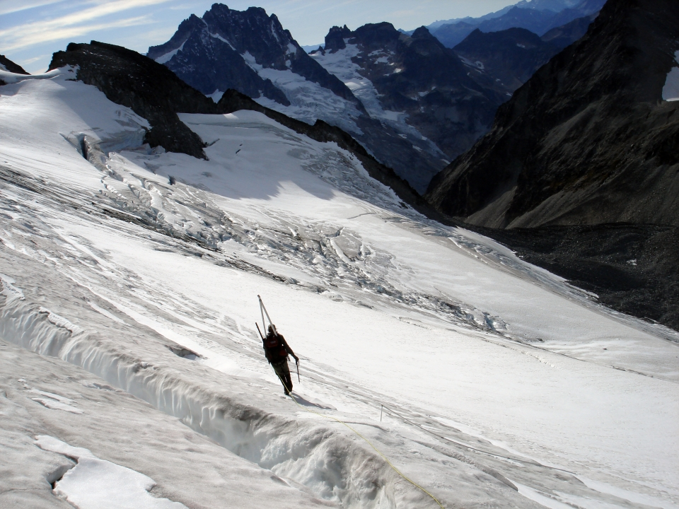 Mountaineering walking on Silver Glacier in the mountains of North Cascades National Park