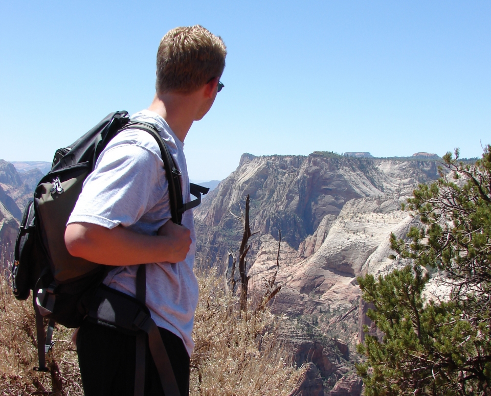 NPF staff Alex looks out from Zion National Park's Observation Point.