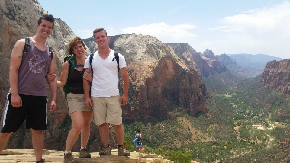 NPF staff Joan stands between her two sons atop Zion National Park's Angels Landing.