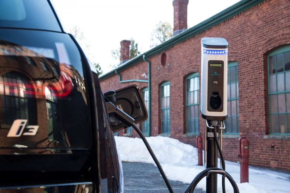 BMW i3 electric vehicle plugged into a charging station at Thomas Edison National Historical Park in West Orange, NJ.