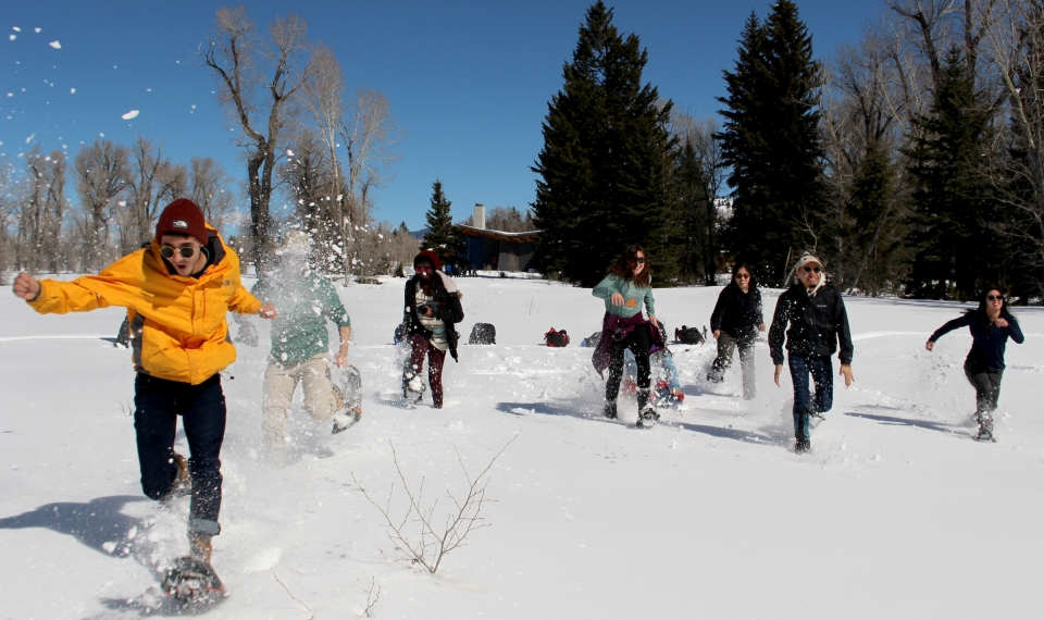 A group of students having a snowshoe race at Grand Teton National Park