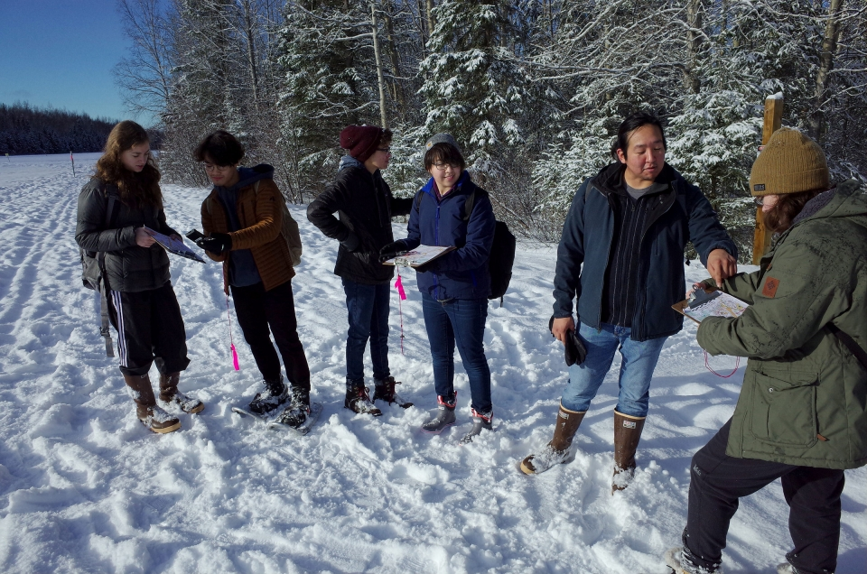 A group of diverse students learning orienteering at the Campbell Creek Science Center