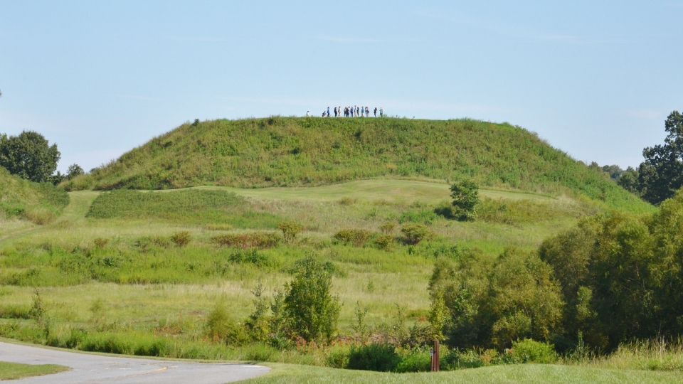 People walking atop Great Temple Mound at Ocmulgee National Monument