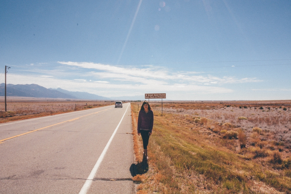 Open Road with woman walking