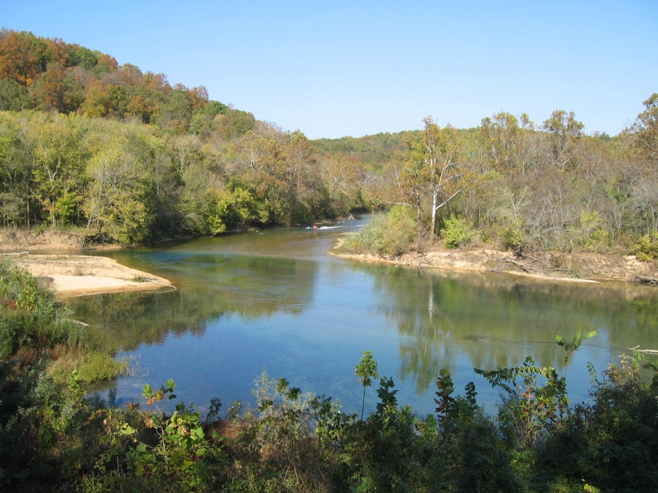 Junction of Jacks Fork and Current River surrounded by trees at the Ozark National Scenic Riverways