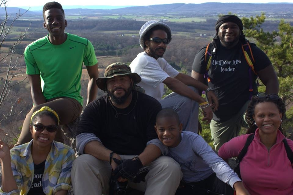 Group of seven African Americans from Outdoor Afro hiking outside.