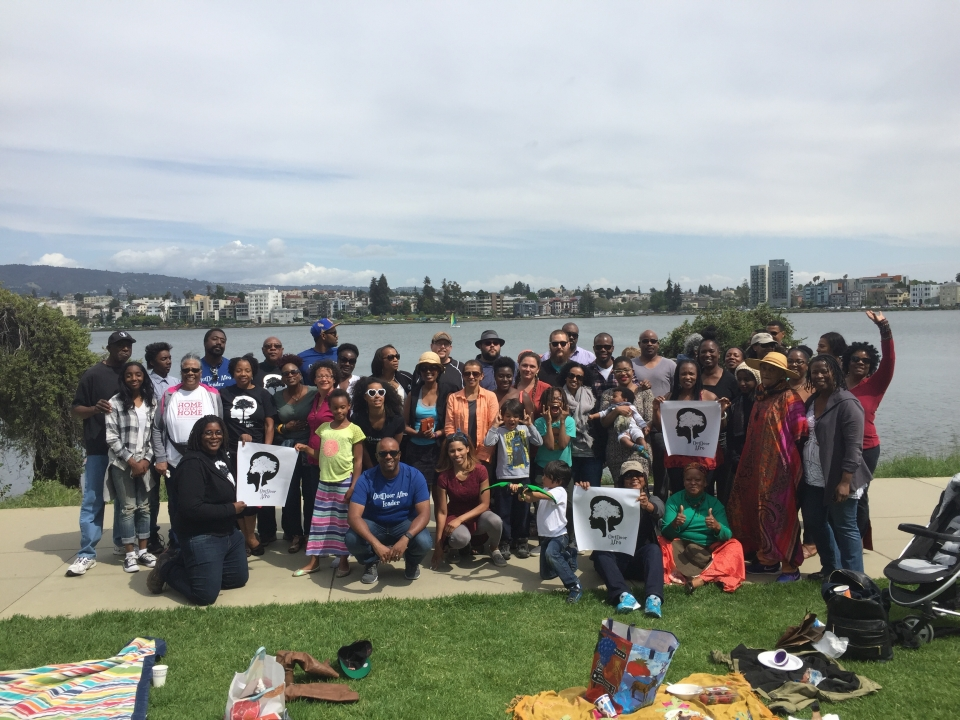 Outdoor Afro group posing in front of Lake Merritt in Oakland, California