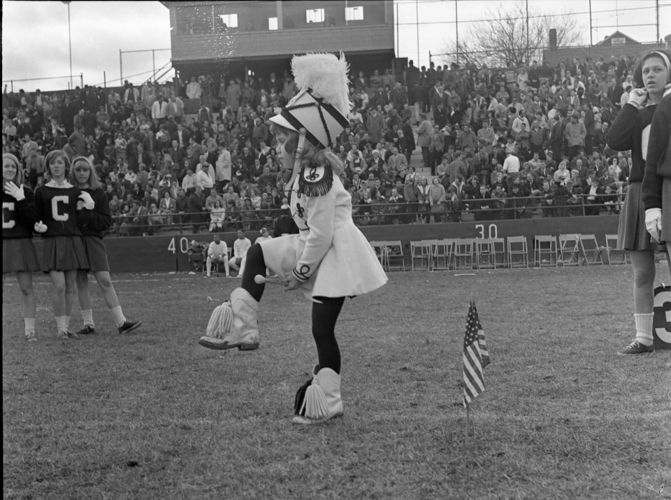 Black and white photo of a young girl dressed up as a drum major at Hinchliffe Stadium at Paterson Great Falls National Park