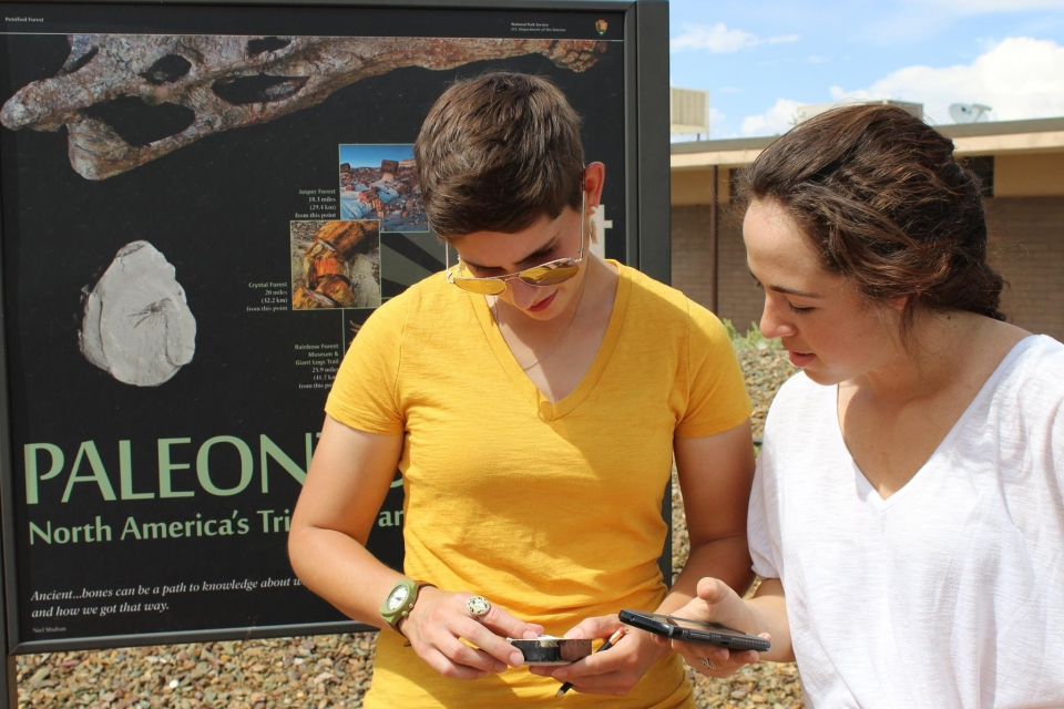 Two people geocaching at Petrified Forest National Park