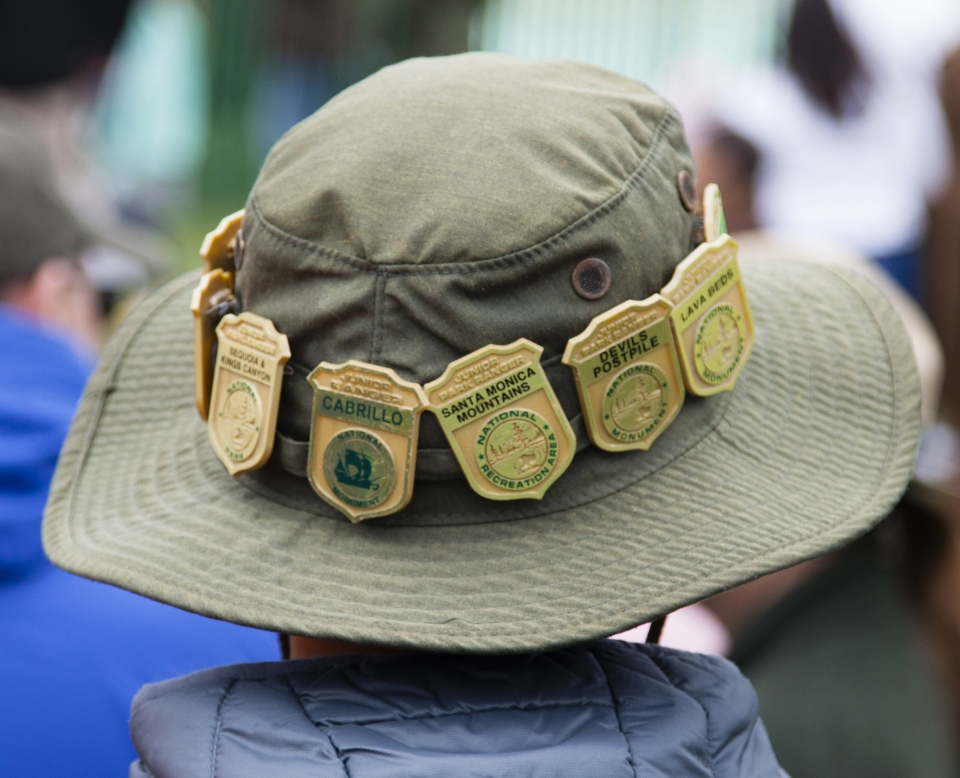 A Junior Ranger showcases his badges from across the country