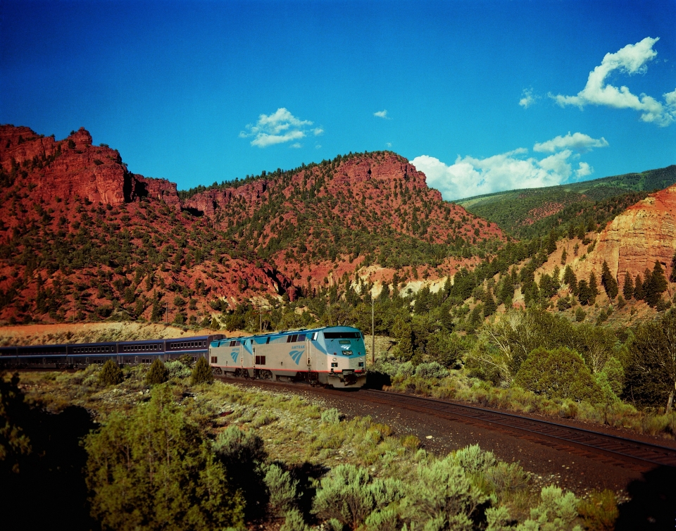 Amtrak train going through the red canyons of Grand Canyon National Park