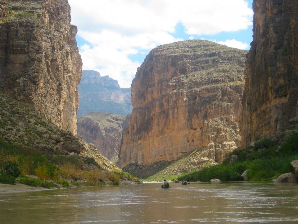 Canoers palling on the Rio Grande Wild & Scenic River in Big Bend National Park towards Boquillas Canyon