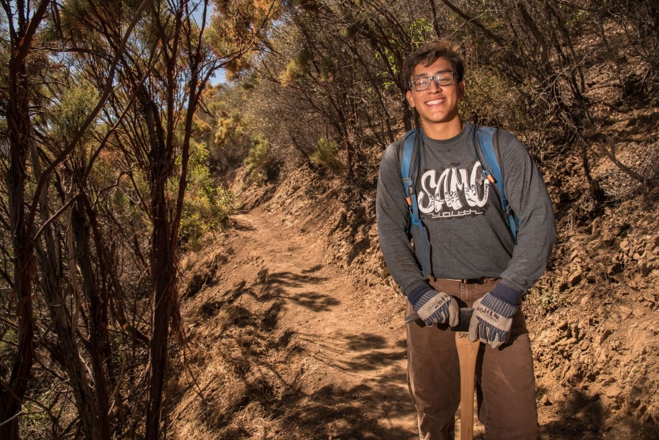Latino youth Andrew Hernandez grinning at Santa Monica Mountains National Recreation Area