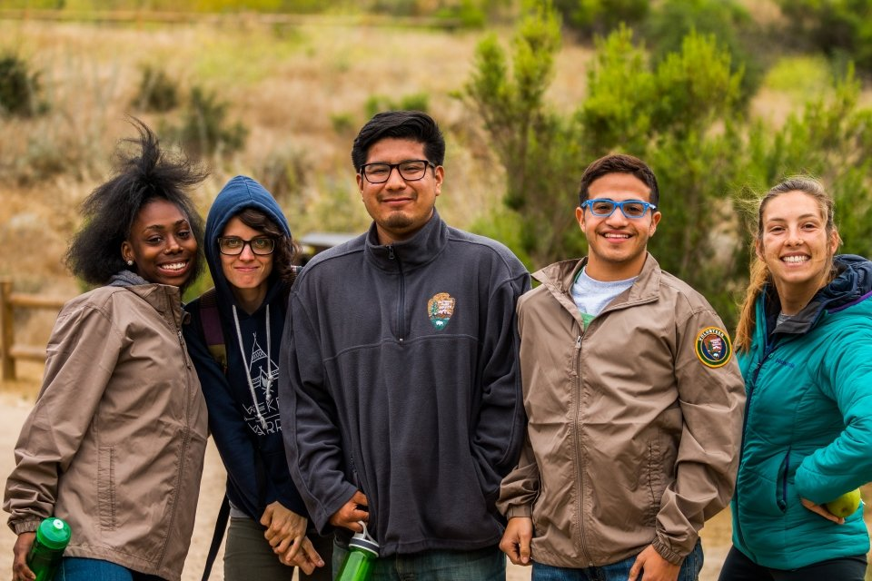 A group of five park interns and volunteers on a hike, Santa Monica Mountains National Recreation Area