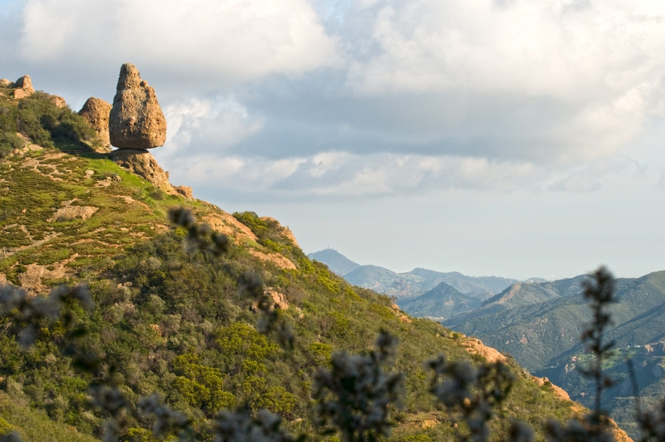 View of the rocky green hills on the Mishe Mokwa Trail at the Santa Monica Mountains National Recreation Area, a park in southern California