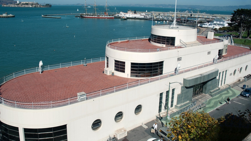 The San Francisco Maritime Museum is in the historic Aquatic Park Bathhouse Building along the pier in the San Francisco Bay