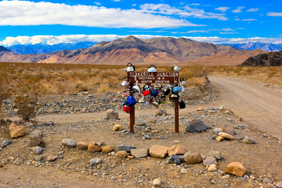 Teakettle Junction is a popular location in Death Valley, where hikers leave teakettles