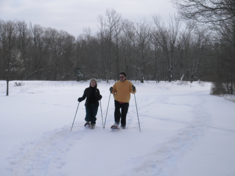 Two people snowshoeing at Sleeping Bear Dunes National Park