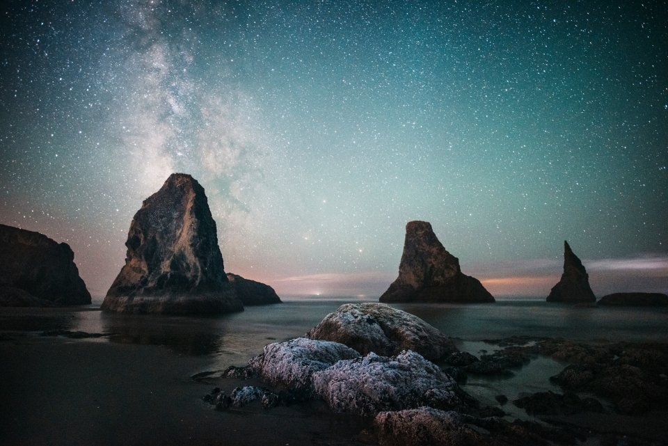 Starry night sky with the milky way over the rocks on the coast at Oregon Islands National Wildlife Refuge