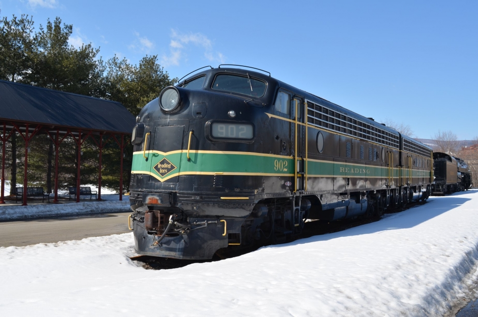 Black and green of the Reading Company's FP7s train in the snow at Steamtown National Historic Site