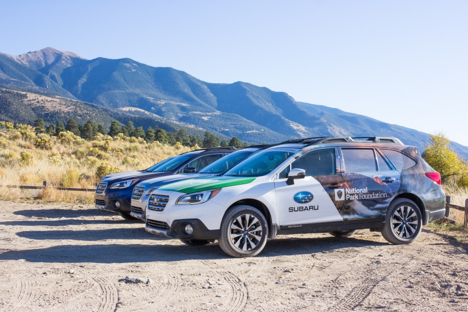 Three Subarus lined up against the backdrop of Great Sand Dunes National Park & Preserve